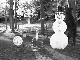Look mom, I'm as tall as the snowman. Thank you to Kim Peachey for submitting this picture. 8-12-08