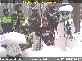 The Bailey family out for a snowmobile ride stop by to visit the snowman cam.