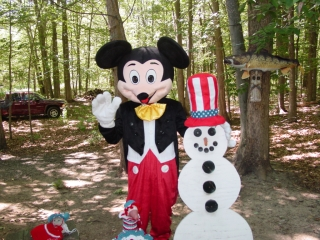 Mickey Mouse visits the Snowman over the 4th of July holiday.