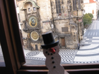 One of RJG's snowmen in Prague, Czech Republic. 14th Century Prague Astronomical Clock - Old Town Hall Clock in the background. Photo submitted by Anne Grethe Riesenmey (Norway)