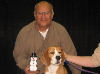 Richard Guccini and Snowman posing with Uno, winner Best of Snow 2008 Westminster Dog Show.