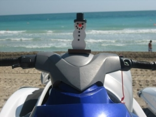 Snowman doing some jetskiing and enjoying a winter break on South Beach in Miami Florida. Picture by Richard Guccini.